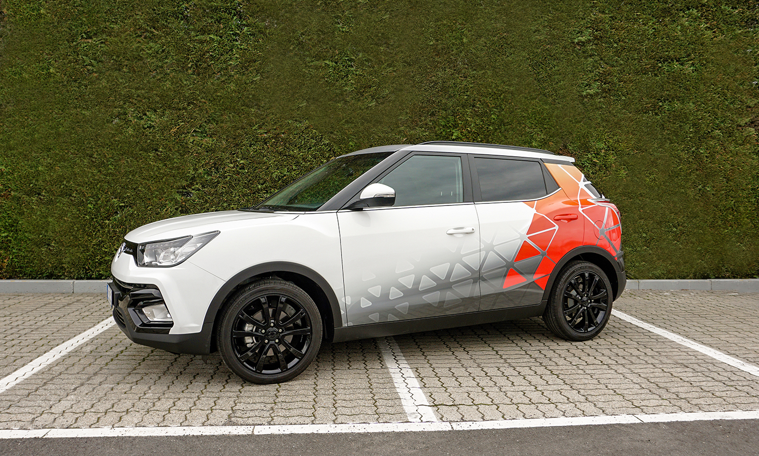 https://kubelibre.com/uploads/Slider-work-tutti-clienti/ssangyong-tivoli-design-take-over-exhibition-mudec-milano-3.jpg